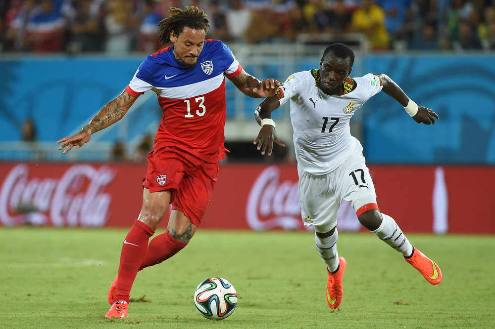 Description of . US midfielder Jermaine Jones (L) jumps for the ball with Ghana's midfielder Mohammed Rabiu (R) during a Group G football match between Ghana and US at the Dunas Arena in Natal during the 2014 FIFA World Cup on June 16, 2014.  AFP PHOTO / EMMANUEL DUNANDEMMANUEL DUNAND/AFP/Getty Images