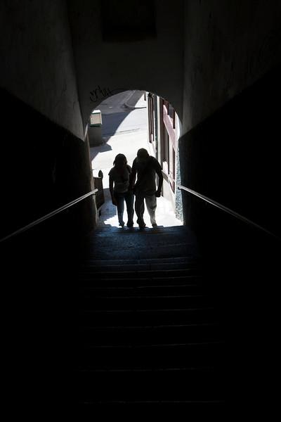 Couple through a passageway, town of Leon, autonomous community of Castilla y Leon, northern Spain