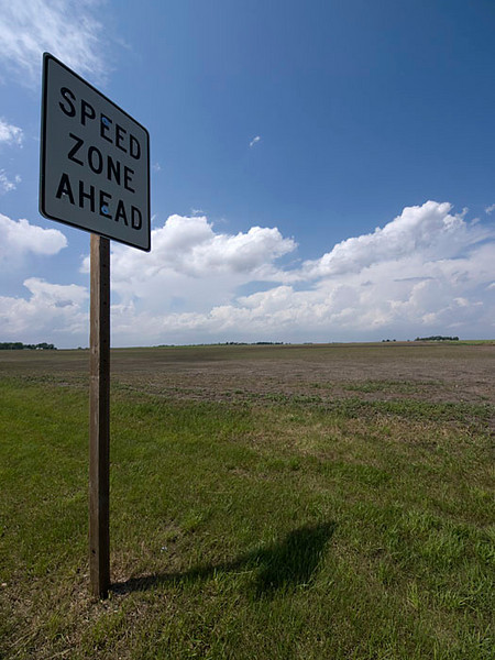 Love the signs, terrain & weather out here in the Plains.