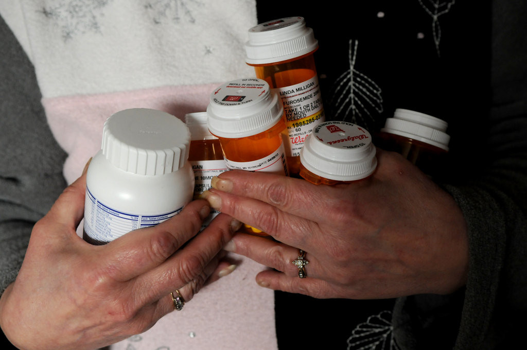 . Linda Milligan shows medications she needs that couldn\'t be refilled when her husband Ron Milligan\'s insurance was mistakenly canceled. (Pioneer Press: Jean Pieri)
