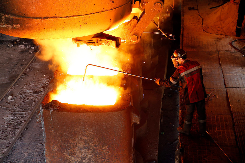 . An employee operates machinery on a mold for metal ingots inside the Zaporizhstal steel plant, owned and operated by Metinvest BV, at their site in Zaporizhzhya, Ukraine, on Monday, Oct. 14, 2013. Metinvest BV, Ukraine\'s largest steelmaker, last year acquired 49.9% in steelmaker Zaporizhstal a manufacturer of semi-finished steel products, including hot and cold-rolled plates and coils. Photographer: Vincent Mundy/Bloomberg