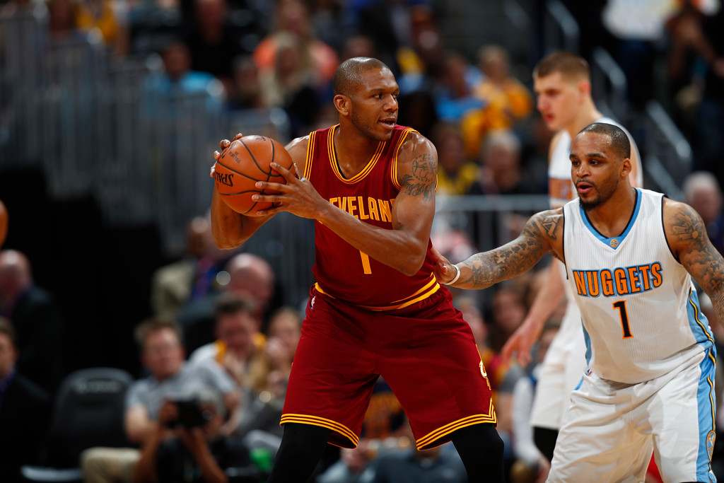 . Cleveland Cavaliers guard James Jones (1) and Denver Nuggets guard Jameer Nelson (1) in the second half of an NBA basketball game Wednesday, March 22, 2017, in Denver. The Nuggets won 126-113. (AP Photo/David Zalubowski)