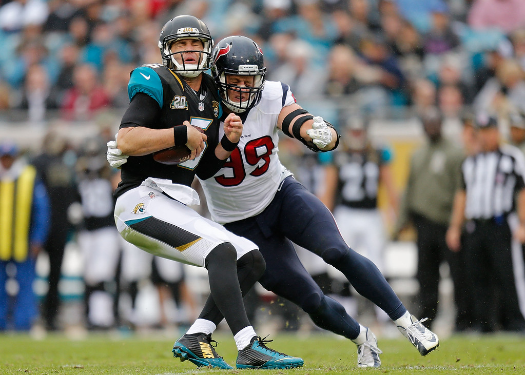 . JACKSONVILLE, FL - DECEMBER 07:  J.J. Watt #99 of the Houston Texans sacks Blake Bortles #5 of the Jacksonville Jaguars during the first half of the game at EverBank Field on December 7, 2014 in Jacksonville, Florida.  (Photo by Rob Foldy/Getty Images)