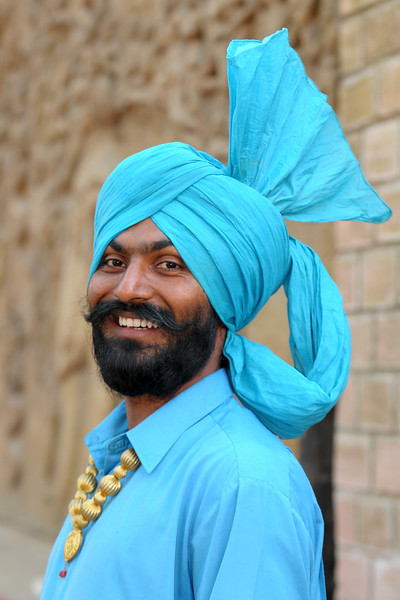 Rajan Singh from Batala, Punjab. The Police band group near the open theatre called Chaupal at Suraj Kund Mela 2009 held in Haryana (outskirts of Delhi), North India. The Suraj Kund Mela is an annual fair held near Delhi. Folk dances, handicrafts and a lot of fun.