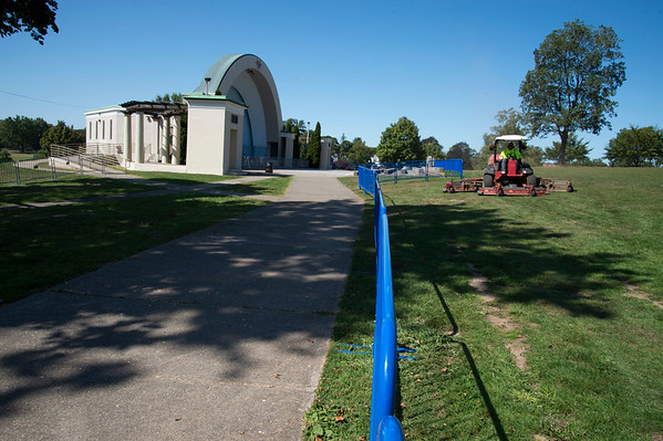 09/19/19 Wesley Bunnell | StaffrrCity workers were busy making improvements to Walnut Hill Park on Thursday as well as setting up security measures for the expected crowd for Sunday's visit by the Polish President. A city worker owes the lawn in front of security fencing has bee set up in front of the band shell where the president will speak.