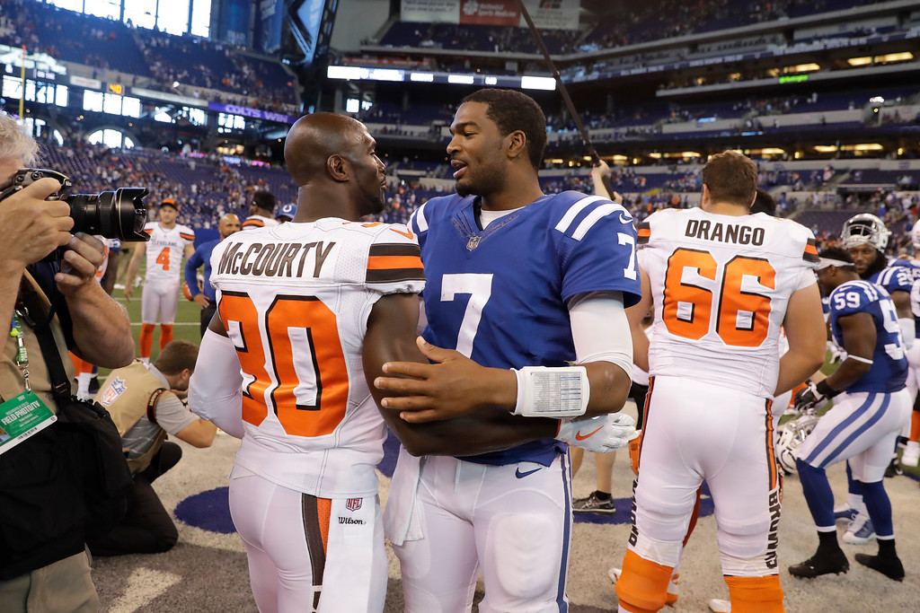 . Indianapolis Colts quarterback Jacoby Brissett (7) greets Cleveland Browns cornerback Jason McCourty (30) during the second half of an NFL football game in Indianapolis, Sunday, Sept. 24, 2017. The Colts defeated the Browns 31-28. (AP Photo/Darron Cummings)