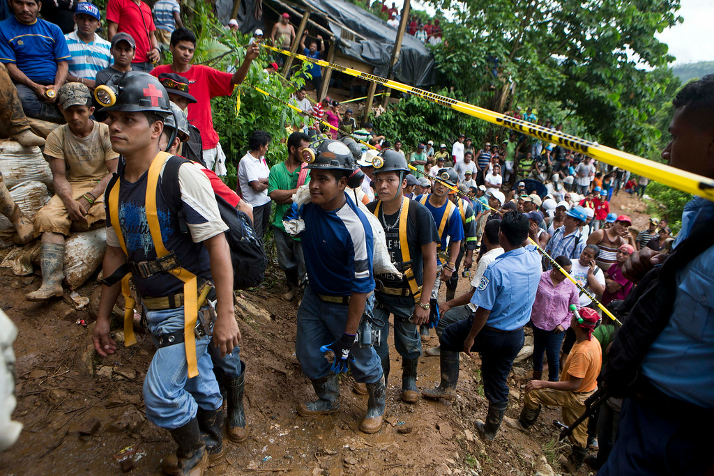 . Miners walk in line as they enter the El Comal mine to help in the rescue operations at the gold and silver mine after a landslide trapped at least 24 miners inside, in Bonanza, Nicaragua, Friday, Aug. 29, 2014. Rescuers on Friday located 20 of at least 24 gold miners trapped by a landslide in northern Nicaragua, but were not immediately able to bring them to safety. (AP Photo/Esteban Felix)