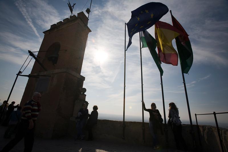 Flags and belfry on the top of Torre de la Vela, Granada, Spain
