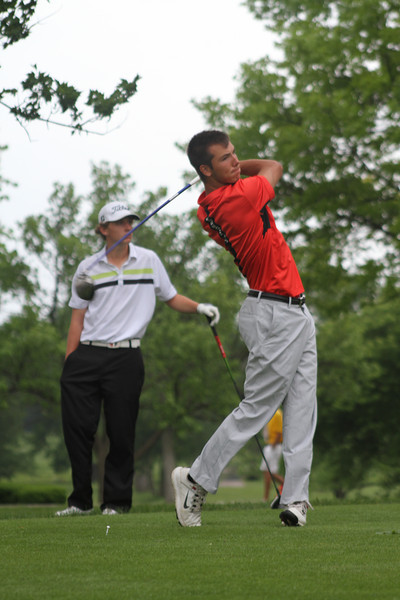 John Mancinotti of Toledo, Ohio tees off during the first round of the 2014 Western Junior Championship.