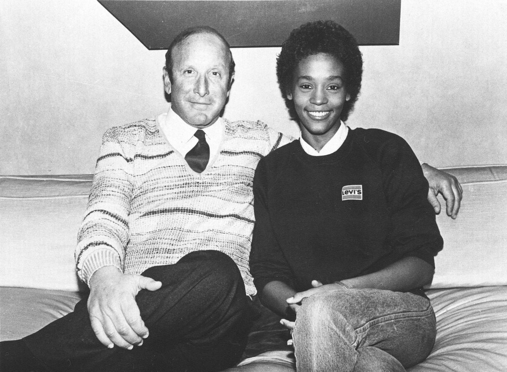 . Rising star Whitney Houston is seen with music producer Clive Davis, in 1983, shortly after signing a contract with Arista Records. (AP Photo)