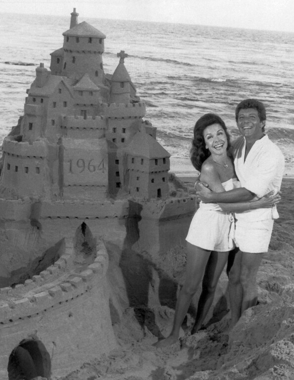 ". Frankie Avalon and Annette Funicello, who co-starred in ""beach party\"" movies during the 1960s, have their feet in the sand again, Oct. 18, 1978. (AP Photo)"