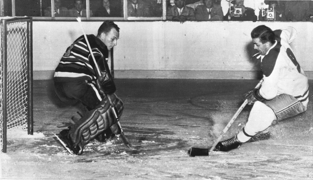 ". Maurice ""Rocket\"" Richard of the Montreal Canadiens gets ready to fire his first goal past Chicago Black Hawks goalie Al Rollins, during the Montreal-Chicago NHL season opener, Oct. 7, 1954.  The Canadiens defeated the Black Hawks, 4-2.  (AP Photo)"