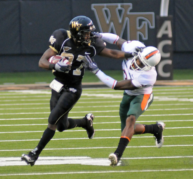 J Adams run and stiff arm.jpg