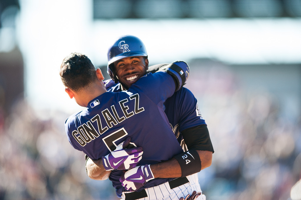 . DENVER, CO - JUNE 1:  Dexter Fowler #24 and Carlos Gonzalez #5 of the Colorado Rockies celebrate Fowler\'s 10th inning walk off single against the Los Angeles Dodgers at Coors Field on June 1, 2013 in Denver, Colorado. The Rockies beat the Dodgers 7-6 in 10 innings. (Photo by Dustin Bradford/Getty Images)