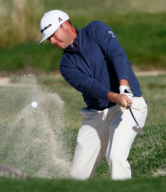 . Chez Reavie hits out of a bunker on the 2nd hole at the Pebble Beach Golf Links during the final round of the AT&T Pebble Beach Pro-Am on Sunday, Feb. 11, 2018.  (Vern Fisher - Monterey Herald)