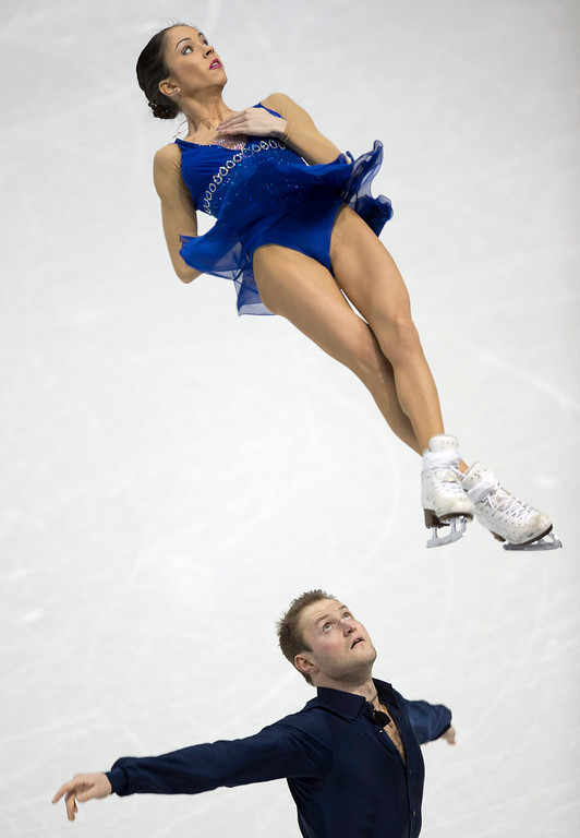 . Vera Bazarova and Yuri Larionov of Russia perform in the pairs short program as the World Figure Skating Championships in London, Ontario, on Wednesday, March 13, 2013. (AP Photo/The Canadian Press, Frank Gunn)