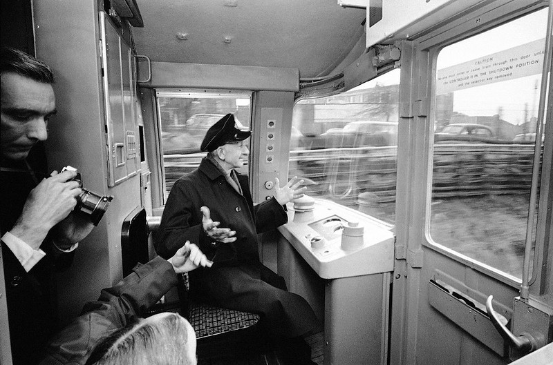 . London transport underground train driver Mr. Earnest Coulson, 60, who has 41 years of service with London transport, takes his hands from the controls of the tube train as it was guided by electronic impulses on the \'shuttle\' section of the Woodford-Hainualt line in London, United Kingdom, on Feb. 19, 1968. The train picks up coded impulses from the main track which causes the train to accelerate, coast and brake to a halt at the next station, obeying all instructions given on the way, and slowing down or stopping or restarting as required if there is another train or a speed restriction on part of the route. The train operator, stationed in the front cab, closes the doors and presses the twin \'start\' buttons at the beginning of the run. He can also take over the in the event of failure of the automatic equipment. (AP Photo/Victor Boyton)