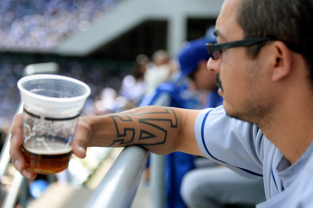 . Miguel Eribes watches the Dodgers-Giants game, Friday, April 4, 2014, at Dodger Stadium. (Photo by Michael Owen Baker/L.A. Daily News)