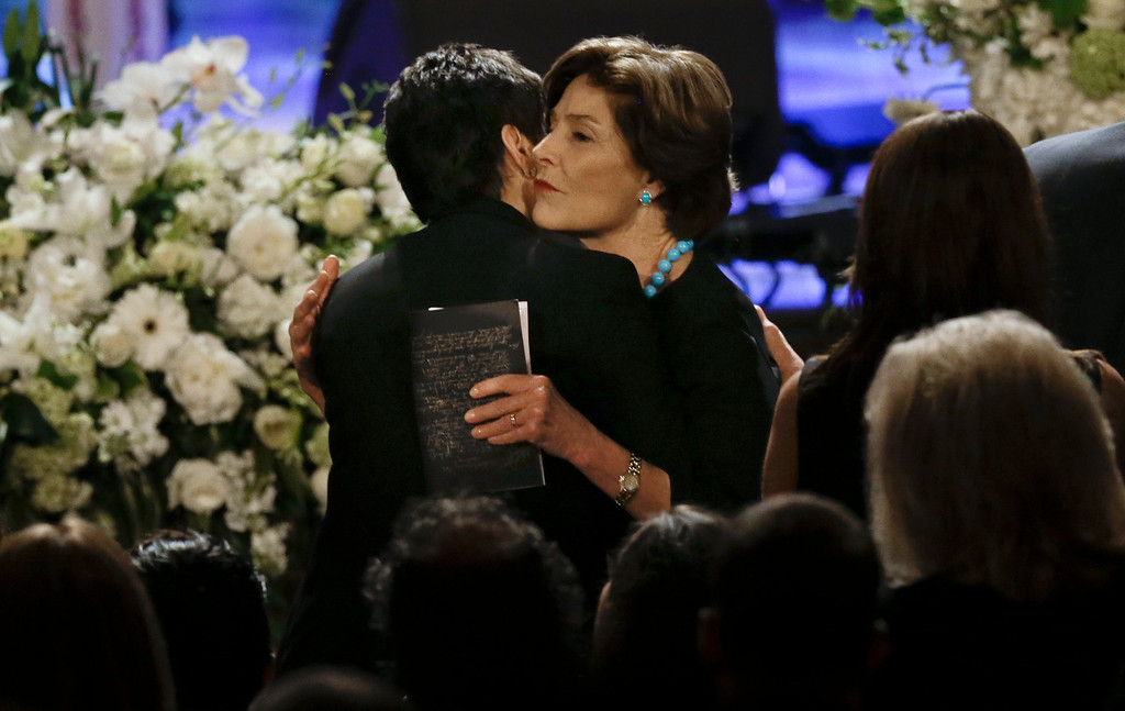 . Former first lady Laura Bush hugs Nancy Jones, left, the widow of country music star George Jones during the funeral for George Jones in the Grand Ole Opry House on Thursday, May 2, 2013, in Nashville, Tenn.  (AP Photo/Mark Humphrey, Pool)