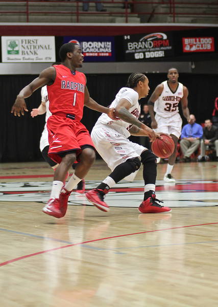 Tashan Newsome(3) dribbles down the court.
