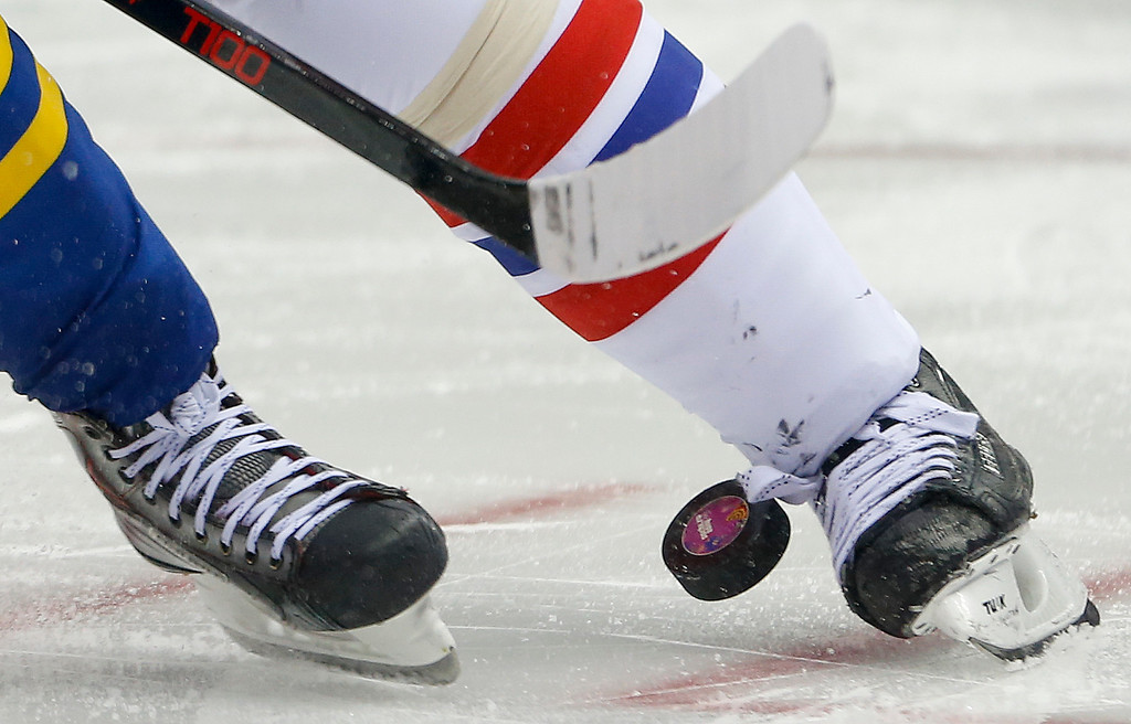 . Sweden and the Czech Republic face off in the third period of a men\'s ice hockey game at the 2014 Winter Olympics, Wednesday, Feb. 12, 2014, in Sochi, Russia. (AP Photo/Mark Humphrey)
