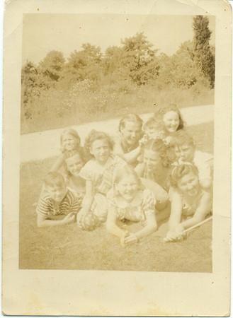 1938, August: Eileen Keeney, Mary Kelly, Nan Brennan, Rere (Marie) Keeney, Gloria Kuehne, Gerard Frost, Helen Keeney, George F. Frost, Jimmy Brennan, Teresa Brennan, Kate Brennan. Mastic, NY.