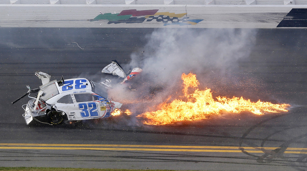 . Kyle Larson\'s car comes apart after a crash at the conclusion of the NASCAR Nationwide Series auto race Saturday, Feb. 23, 2013, at Daytona International Speedway in Daytona Beach, Fla. (AP Photo/Chris O\'Meara)