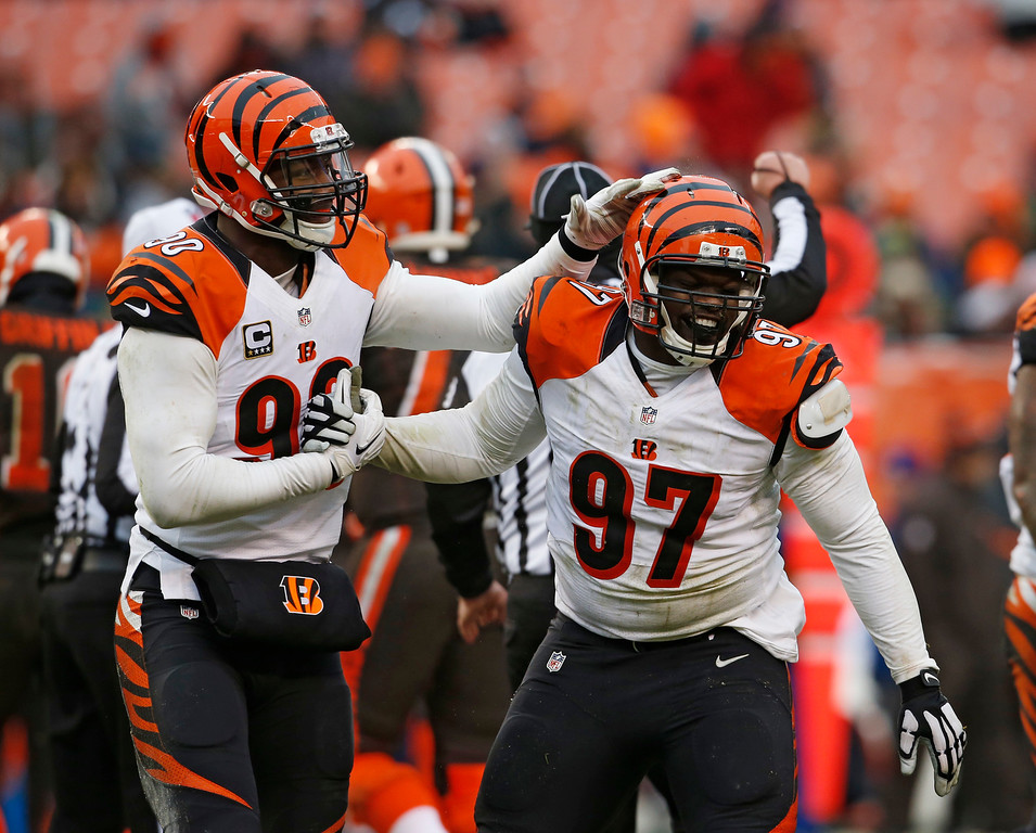 . Cincinnati Bengals defensive tackle Geno Atkins (97) is congratulated after a sack in the second half of an NFL football game against the Cleveland Browns, Sunday, Dec. 11, 2016, in Cleveland. (AP Photo/Ron Schwane)