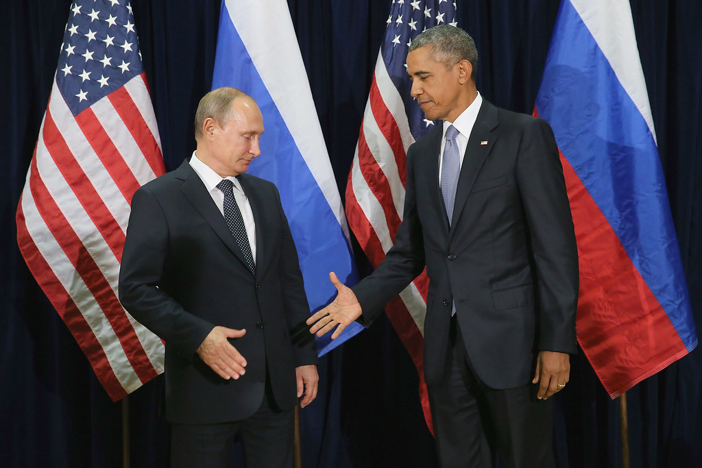 . Russian President Vladimir Putin (L) and U.S. President Barack Obama shake hands for the cameras before the start of a bilateral meeting at the United Nations headquarters September 28, 2015 in New York City. Putin and Obama are in New York City to attend the 70th anniversary general assembly meetings.  (Photo by Chip Somodevilla/Getty Images)
