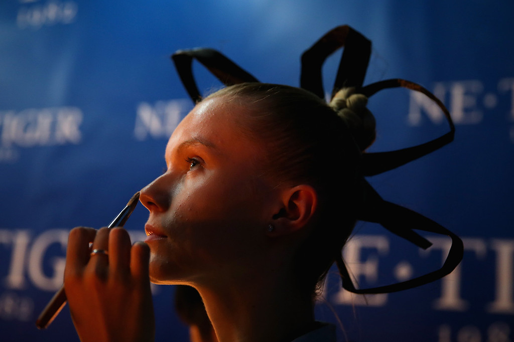 . BEIJING, CHINA - OCTOBER 25:  A model prepares backstage ahead of 2014 NE-TIGER Haute Couture Collection show during Mercedes-Benz China Fashion Week Spring/Summer 2014 at Beijing Hotel on October 25, 2013 in Beijing, China.  (Photo by Feng Li/Getty Images)
