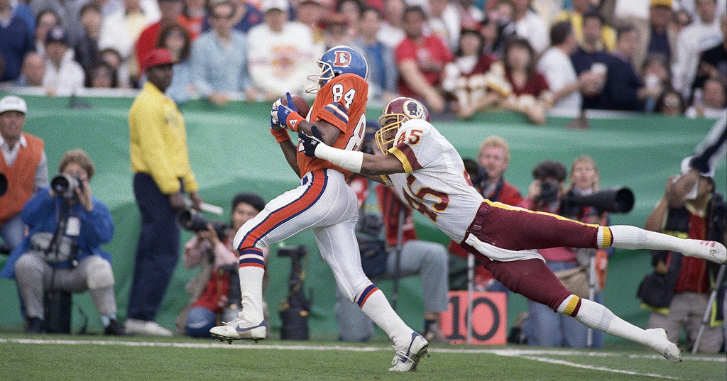 . Washington Redskins cornerback Barry Wilburn (45) tries to stop Denver Broncos Ricky Nattiel (84) from getting into the endzone after Nattiel hauled in pass from quarterback John Elway during first quarter of Super Bowl XXII, Sunday, Jan. 31, 1988 in San Diego. Nattiel scored on the 56-yard play. (AP Photo/Lenny Ignelzi)