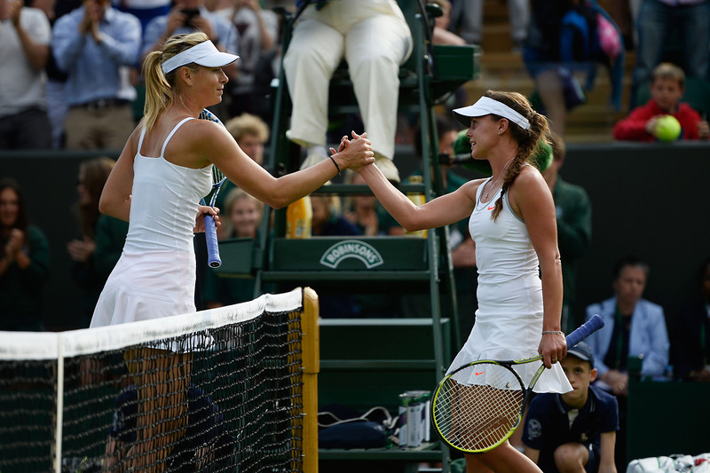 . Michelle Larcher de Brito of Portugal shakes hands at the net with Maria Sharapova of Russia after their Ladies\' Singles second round match on day three of the Wimbledon Lawn Tennis Championships at the All England Lawn Tennis and Croquet Club on June 26, 2013 in London, England.  (Photo by Dennis Grombkowski/Getty Images)