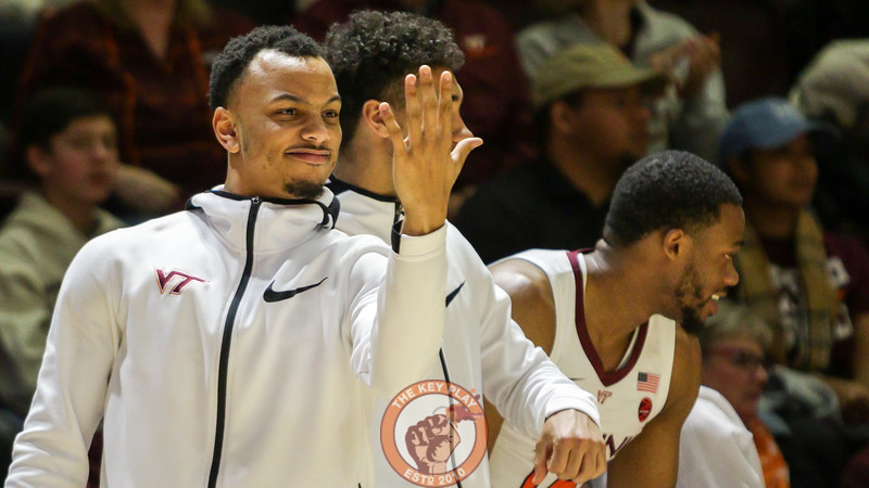 Justin Robinson waves his hand in front of his face after while celebrating another Virginia Tech three point shot. The Hokies were 14/26 from three on the day. (Mark Umansky/TheKeyPlay.com)