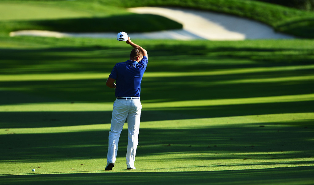 . Henrik Stenson of Sweden looks dejected on the 16th hole during the final round of the 95th PGA Championship on August 11, 2013 in Rochester, New York.  (Photo by Stuart Franklin/Getty Images)