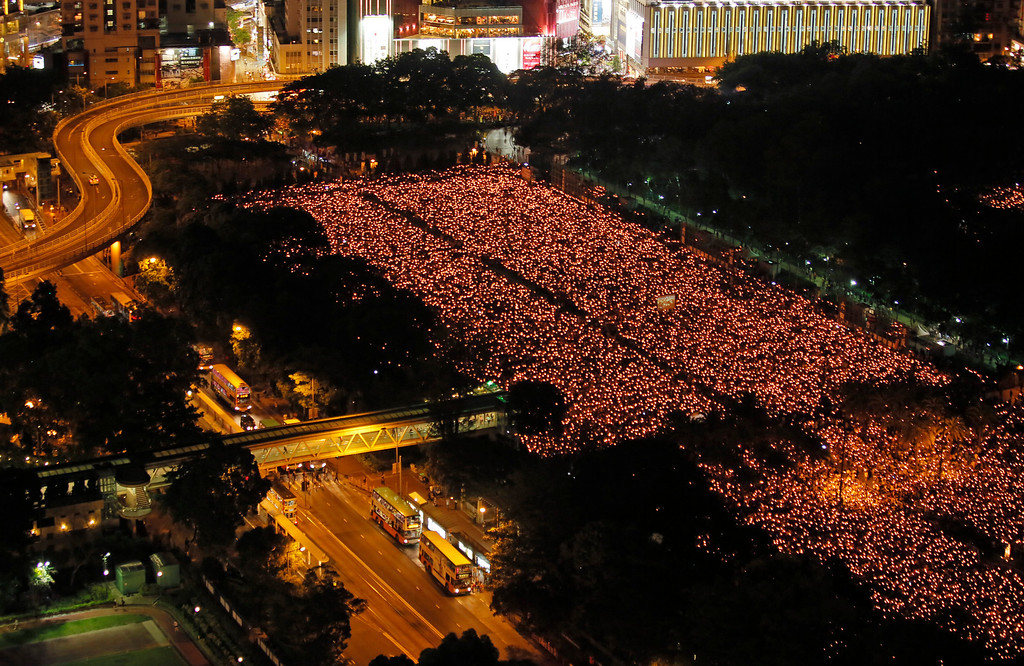 . Tens of thousands of people attend a candlelight vigil at Victoria Park in Hong Kong Wednesday, June 4, 2014 to mark the 25th anniversary of the June 4th Chinese military crackdown on the pro-democracy movement in Beijing. (AP Photo/Vincent Yu)