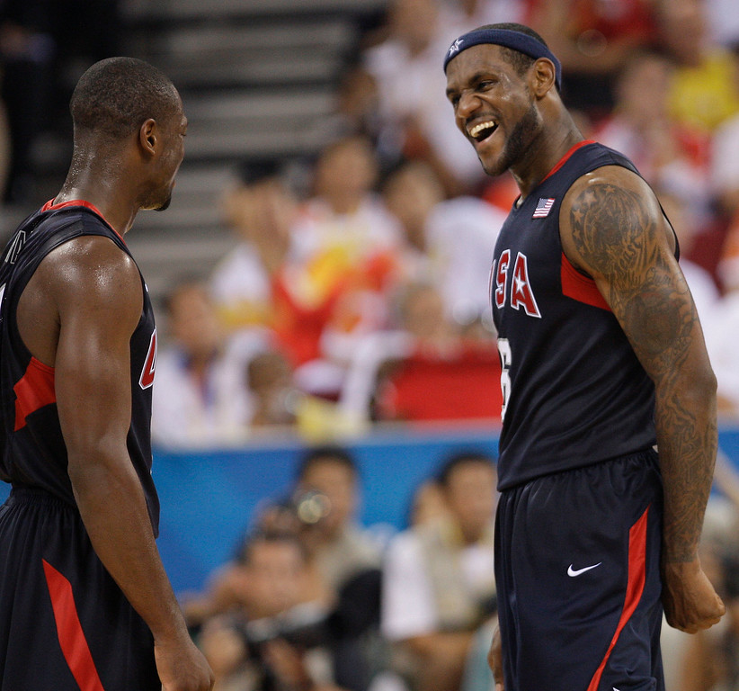 . USA\'s Lebron James, right, reacts towards teammate Dwyane Wade following their win over Spain in their men\'s gold medal basketball game at the Beijing 2008 Olympics in Beijing, Sunday, Aug. 24, 2008.  (AP Photo/Eric Gay)