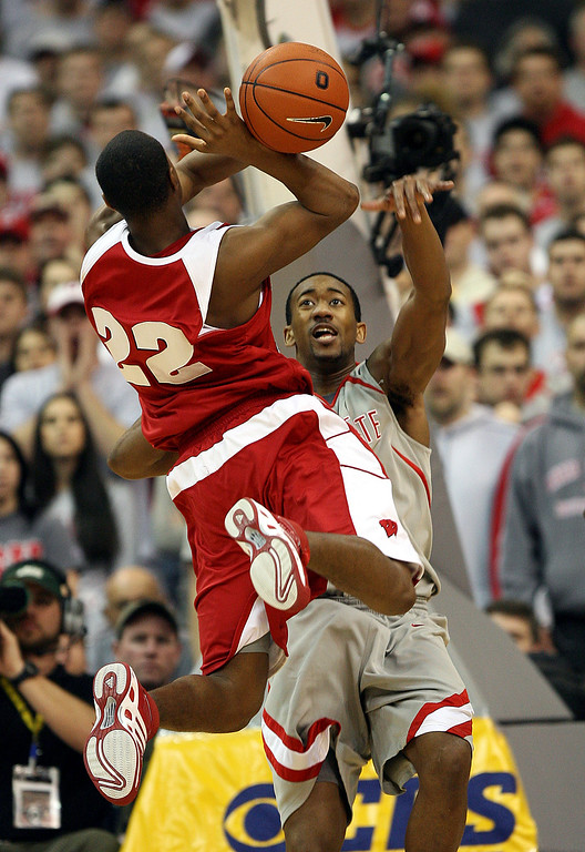 . Wisconsin\'s Michael Flowers (22) has the ball knocked away by Ohio State\'s David Lighty as he drives to the basket during the first half of a basketball game Sunday, Feb 25, 2007, in Columbus, Ohio. (AP Photo/Terry Gilliam)