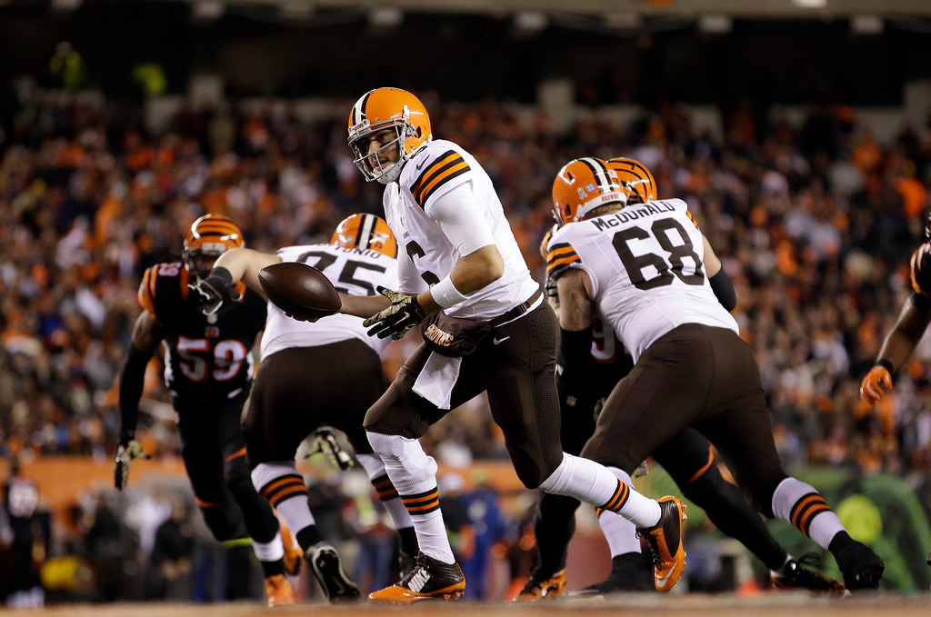. Cleveland Browns quarterback Brian Hoyer looks to hand off during the second half of an NFL football game against the Cincinnati Bengals Thursday, Nov. 6, 2014, in Cincinnati. (AP Photo/AJ Mast)