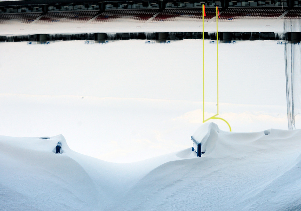 ". An aisle is drifted over and seats are filled with snow at Ralph Wilson Stadium in Orchard Park, N.Y. Friday, Nov. 21, 2014. Snowed out in Buffalo, the Bills are heading to Detroit to play their ""home\"" NFL football game against the New York Jets on Monday night, Nov. 24, 2014. (AP Photo/Gary Wiepert)"