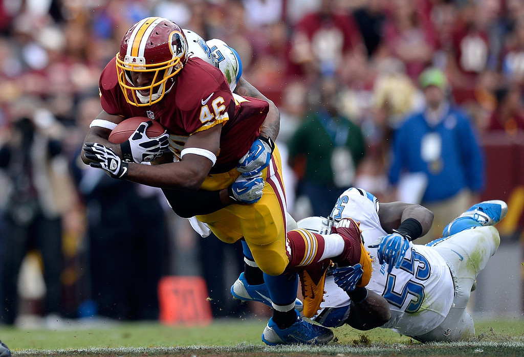 . Alfred Morris #46 of the Washington Redskins is tackeld by Stephen Tulloch #55 of the Detroit Lions in the second quarter during a game at FedExField on September 22, 2013 in Landover, Maryland.  (Photo by Patrick McDermott/Getty Images)