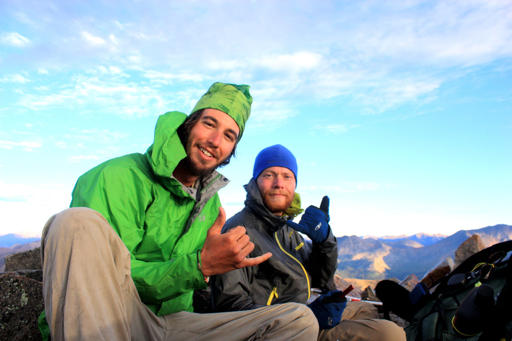 . Luke DeMuth, left, and Junaid Dawud rest atop La Plata Peak in the Sawatch Range in early September. The pair have hiked 1,300 miles and climbed 57 of the state\'s 58 14,000-foot peaks and plan to finish their 70-day mission Sunday on Longs Peak.