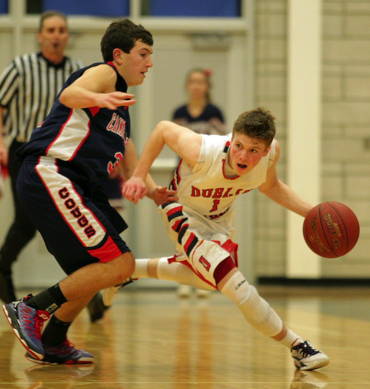 . Dublin\'s Devin Koeplin (1) drives past Campolindo\'s Andrew Zoliutakis (2) in the second half of their high school basketball game in Dublin, Calif., on Friday, Jan. 18, 2013. (Anda Chu/Staff)