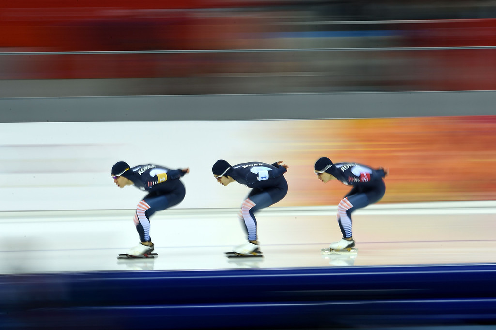 . (L-R) South Korea\'s Lee Seung-Hoon, Joo Hyong-Jun and Kim Cheol-Min compete in the Men\'s Speed Skating Team Pursuit Quarterfinals at the Adler Arena during the Sochi Winter Olympics on February 21, 2014. DAMIEN MEYER/AFP/Getty Images
