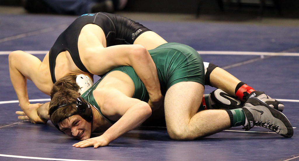 . De La Salle\'s Aaron Pease struggles against Sultana\'s Corey Griego in a 170-pound third round match during the California Interscholastic Federation wrestling championships in Bakersfield, Calif., on Friday, March 1, 2013. (Anda Chu/Staff)
