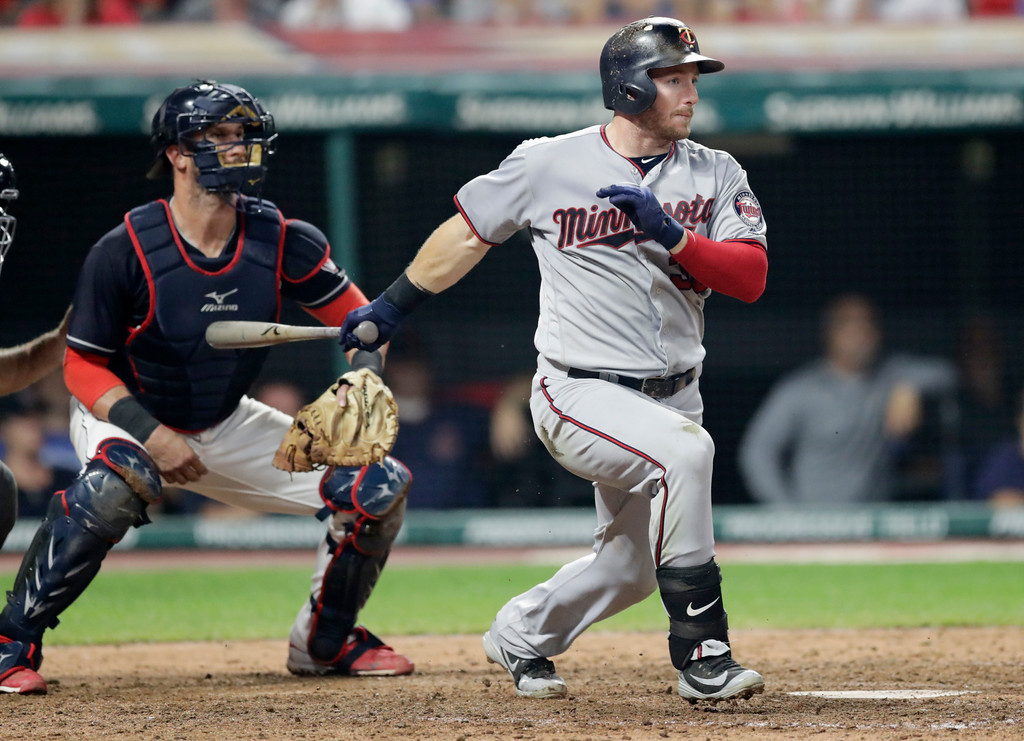. Minnesota Twins\' Robbie Grossman watches his two-run single off Cleveland Indians relief pitcher Cody Allen during the seventh inning of a baseball game, Wednesday, Aug. 29, 2018, in Cleveland. At left is Indians catcher Yan Gomes. (AP Photo/Tony Dejak)