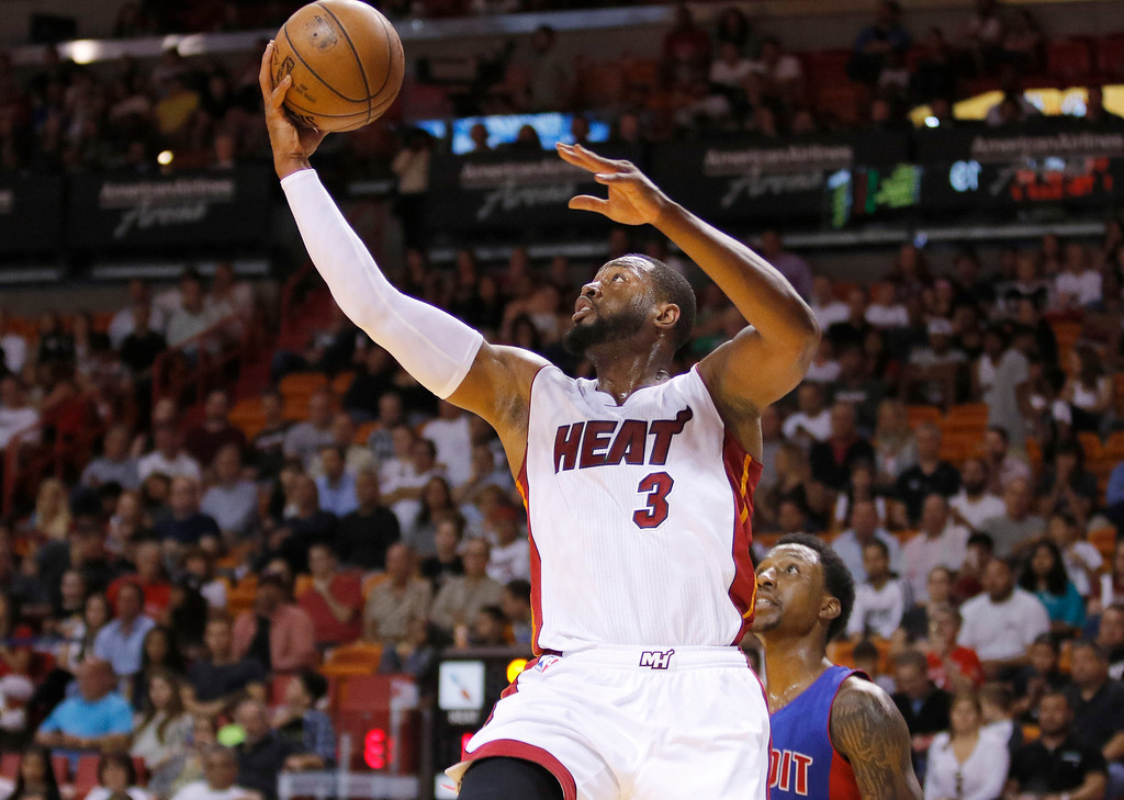 . Miami Heat guard Dwyane Wade shoots as Detroit Pistons guard Kentavious Caldwell-Pope trails during the first half of an NBA basketball game, Sunday, March 29, 2015, in Miami. (AP Photo/Joe Skipper)