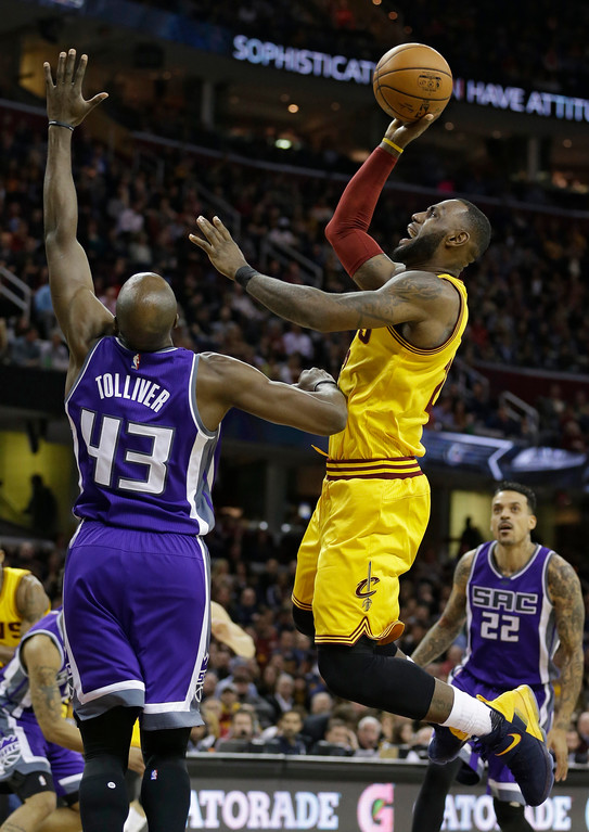 . Cleveland Cavaliers\' LeBron James (23) drives against Sacramento Kings\' Anthony Tolliver (43) during the second half of an NBA basketball game, Wednesday, Jan. 25, 2017, in Cleveland. The Kings won 116-112 in overtime. (AP Photo/Tony Dejak)