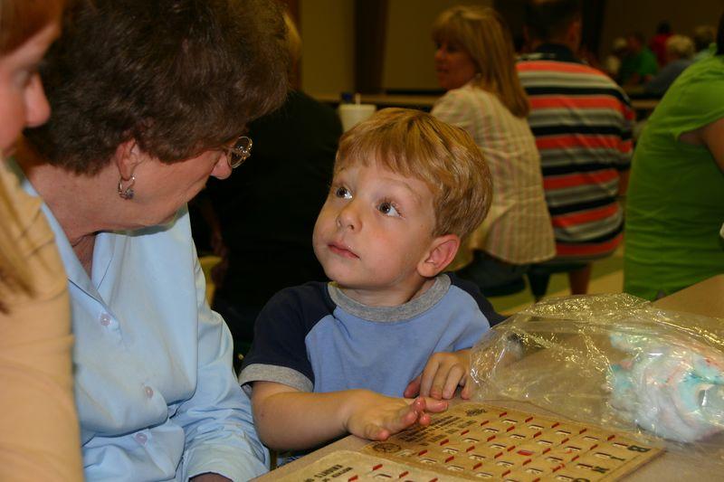 Teaching Grandma how to play Bingo.