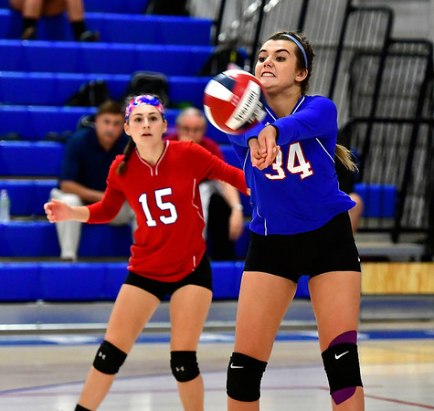 9/27/2018 Mike Orazzi | Staff St. Paul Volleyball's Grace Carabetta (15) and Morgan Kolb (34) Thursday night in Bristol.