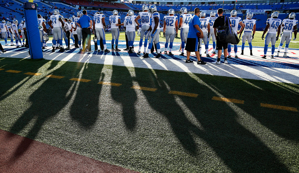 . Detroit Lions players warm up before a preseason NFL football game against the Buffalo Bills, Thursday, Aug. 28, 2014, in Orchard Park, N.Y. (AP Photo/Bill Wippert)